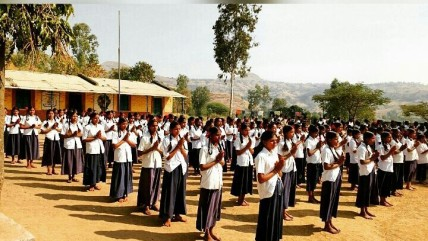 Standing in line with one hand distance @A school in Akole